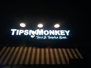 Tipsy Monkey Lighted Storefront Sign